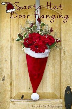 DIY Santa Hat Door Hanging with Flowers. beautiful decoration for outside the home for Christmas time. Noel Christmas, All Things Christmas, Winter Christmas, Christmas Ornaments, Homemade Christmas, Cheap Christmas Decorations, Christmas Centerpieces, Rustic Christmas, Christmas Swags