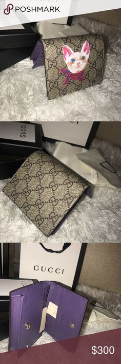Women's Gucci kitty wallet. Brand new women's Gucci kitty wallet.  Super cute wallet.  Comes with tags  Box  Dust bag  And Gucci gift bag.  Ladies you will love this. Gucci Accessories Key & Card Holders