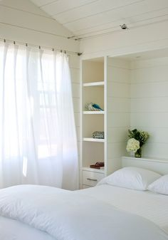 Clean coastal - white clapboards and wall shelves - floor to ceiling nightstand storage.  could paint the bed frames white, walls darker and then build a shelf on each side of the bed