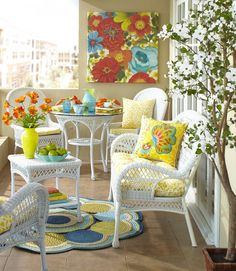 Bold art and sunny accents make all the difference in an outdoor space