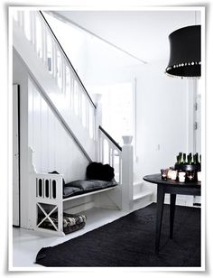 B/W staircase with bench.
