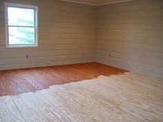 Cheap flooring DIY idea: plywood sheets, cut into 15cm, glued down, stain, and polyurethane. Estimated at less than $1 per meter sq.