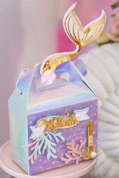 Send your guests home with one of these gorgeous mermaid-themed party favor gable boxes decorated with sea fauna and a gorgeous gold mermaid tail. See more party ideas and share yours at CatchMyParty.com #catchmyparty #partyideas #mermaidparty #mermaids #mermaidpartyideas #underthesea #mermaidfavorbags Mermaid Party Favors, Boy Party Favors, Mermaid Parties, Party Favor Bags, Mermaid Under The Sea, Under The Sea Party, Gable Boxes, Diy Party Supplies, Party In A Box