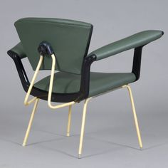 Marluf; Enameled Metal and Lacquered Wood Armchair for L'Atelier, 1950s.