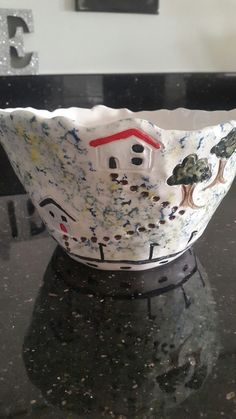 Hand made groggy earthenware  with sponged underglaze with house detail and dipped in clear glaze.