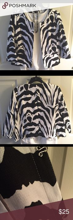Animal print jacket Animal print jacket. Cropped style. Fully lined. 3/4 length sleeves with slit detail. Faux pockets and nice big hook and eye closure. Size L but runs small.  This is a great little dressy jacket! Jackets & Coats Blazers