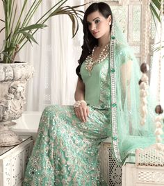 Aqua blue fishtail completely emroidered with sequins work and emerald crystals. Dupatta has for sided border.