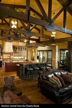 Love the openness of this space and rustic look. #OpenFloorPlan #Rustic #Western