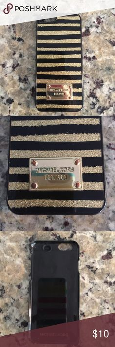Used Michael Kors iPhone 6 plastic phone case Used Michael Kors iPhone 6 case. Gold and Black stripes. Overall condition is ok. MICHAEL Michael Kors Accessories Phone Cases