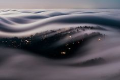 This Long-Exposure Photo Captures Marin County in a River of Fog, Lit by a Full Moon photo by Lorenzo Montezemolo http://www.thisiscolossal.com/2016/09/marin-county-fog/