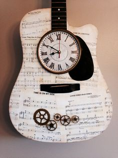Time steam punk acoustic guitar clock...reuses a Fender missing frets, time sheet music, and antique clock parts.