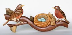 MADE TO ORDER This listing is for a MADE TO ORDER Robins Nest Intarsia. Made from approximately 65 segments and 9 different species of wood. Dimensions are approximately 14 by 6.5. A hanger is attached to the back to easily hang on the wall. The exact colors, grain, and wood types