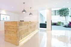 McCann Erickson's reception area and central breakout zone by Office Principles, London: