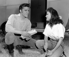 """Elvis Presley (Clint Reno) and Debra Paget (Cathy Reno) on the set of """"Love Me Tender"""", September 1956. The shooting took place from August 23 until October 8, 1956. The outdoor scenes were filmed on a ranch in the San Fernando Valley in California."""