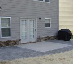 Arbel Pavers used to extend a concrete patio For the Home
