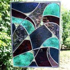 Midnight Blue, Deep Cranberry, Sky Blue and Purple Abstract Stained Glass Panel. $76.00, via Etsy.
