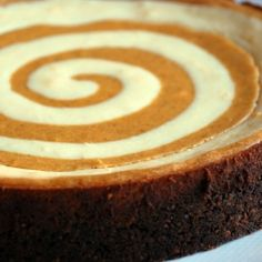 Pumpkin Cheesecake - made with a gingersnap cookie crust, just in time for the holidays.....