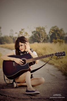 outdoors ..top skirts...model shoots guitar