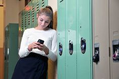 Emma should be on her phone at her locker, maybe looking over her shoulder at her friends whispering behind her back