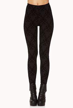 A pair of leggings featuring a velveteen baroque pattern. Elasticized waist. Knit. Lightweight.