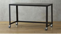 go-cart carbon rolling desk (CB2-- same thing-- you can get 2 to 3 of these for common space since it's rolling)