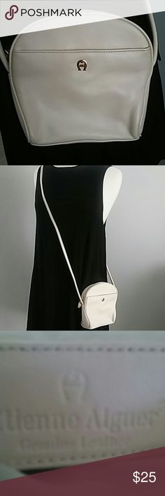 ETIENNE AIGNER IVORY-CREAM LEATHER CROSSBODY BAG ETIENNE AIGNER LOVELY IVORY-CREAM GENUINE LEATHER CROSSBODY BAG. ONE ZIPPER COMPARTMENT INSIDE AND AN OPEN POCKET ON THE EXTERIOR. GREAT LITTLE BAG. Etienne Aigner Bags Crossbody Bags