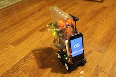 An extremely cute robot, powered by a Raspberry Pi, that goes around relaying a live video feed and shooting nerf bullets.