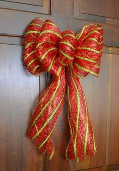 This Christmas bow uses a brand new product - 10 inch wide deco mesh ribbon, which comes in many colors, patterns and finishes.    The only other supplies you will need are scissors and some craft wire or 2 pipe cleaners.
