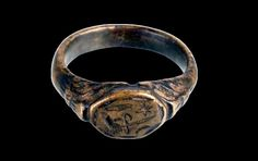 Medieval Serbian ring with engraved hand holding sword, 14th-15th century, found in Ćuprija, central Serbia. Collection of Museum in Jagodina