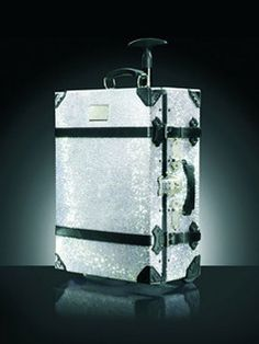 swarovski encrusted samsonite luggage...this would be PERFECT for transporting my fibi & clo trunk shows!!!