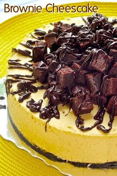 Brownie Cheesecake - a luscious vanilla cheesecake sits atop a chocolate cookie crumb crust and is then topped with mounds of mini brownies and a drizzle of rich chocolate ganache. A true celebration dessert.
