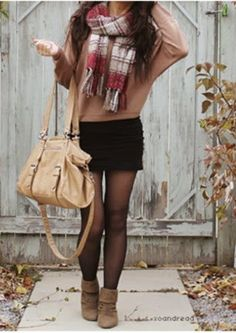 love the baggy skirt with the tight miny skirt with some leggings, and then with a finishing touch, the scarf and ankle boots, it's a must have! ! ! !