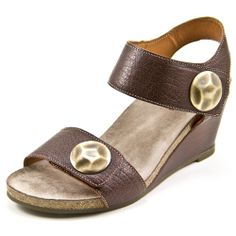 Boardwalk Brown -- Available in 3 colors!  The Taos Boardwalk is an adjustable sandal designed with distressed full grain leather uppers and large antiqued metal medallions for stylish look. Two adjustable velcro straps help hug your feet for a custom-feeling fit. Featuring a flexible contoured latex-padded footbed lined in suede for exceptional comfort and a rubber outsole that is cushioned, durable and ready to take on the challenges of a busy day. Taos sandals are built for comfort.