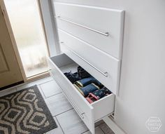 What a great storage solution for a split level entry home! DIY Built in Shoe Storage Drawers