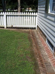 Ground gutter - directs rain water to an underground cistern. So much easier to keep clean than roof gutters!