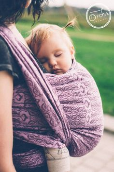 Sleeping baby in Nouveau Sugar Plum baby wrap by Oscha Slings