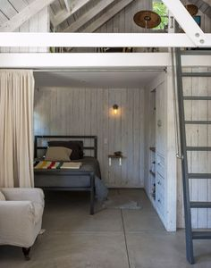 The bedrooms in this Holywood bunkhouse are sectioned off by Pays' signature curtains made from all-cotton painter's drop cloths suspended from galvanized plumber's pipe, both from local home supply store Anawalt Lumber. The metal bed frames are Room & Board's Parsons Twin Bed.