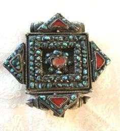 "INTERSECTING SQUARES ~ Antique Tibetan Turquoise Gau, Ghau Box, 82.2 Grams. via Etsy.  Seller says, ""This classic silver Tibetan Ga'u Amulet Box whose form of two intersecting squares symbolize two crossed dorjes, symbol of the ultimate stability of Buddhahood. This style was worn by women and popular in and around Lhasa, Tibet and Sikkim in northern India...."""