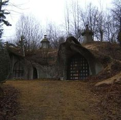"""The Door County Mushroom House Mystery - The most mysterious hobbit hole of all is this more modern construction in Whitefish Bay, WI. Little is known about the earth-bermed dwelling, but its whimsical design has earned it the nickname """"The Door County Mushroom House"""". We don't know who built it, but we do know it wouldn't look out of place on a The Lord of the Rings set."""