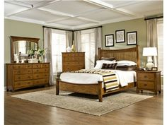 The Pasadena Revival bedroom group from Intercon is made from Oak Veneer and Select Hardwoods and has a Medium Brown finish.  A modern updated version of the oak poster bed.