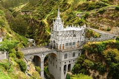 Nestled in Colombia's hilly countryside, Las Lajas Sanctuary was built between 1916 and 1944 to commemorate the Virgin Mary, whose image was reportedly sighted on an enormous rock face above the river. Visitors place plaques on the cliffs that surround the neo-Gothic cathedral, as thanks for the miracles that have occurred there.