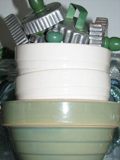 Love the green handle vintage cookie cutters & mixing bowls