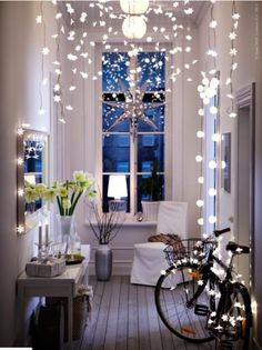 Inspiration to Decorate for the Holidays - Whimsical Light Display - hang strings of lights from the ceiling (like snowflakes) to create a whimsical entryway! IKEA's STRÅLA Light chain, $4.99