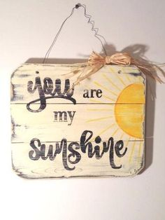 You Are My Sunshine wall sign was handmade and painted on reclaimed pallet wood. It was heavily distressed to give it a warm rustic feel. It's dimensions are approximately 12 x 11, and hangs by mechanic wire with a cute raffia bow. This would make the perfect gift for those on your list that love rustic wall decor. There is not one quite like it out there. New2UDesign
