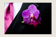 Orchid boutonnieres for the groom's side
