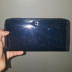Kate Spade Mavis Wallet Offshore Kate spade wallet. Color is offshore. It is a black and blue wallet with shimmer. Very glittery and reflective. Wallet closes with zipper that goes around the wallet. 6 card slots on each side. Zipper for coins. Room for cash on either side. Pouch on back of wallet. Very, very little wear on outside only noticeable if looking really hard as pictures show most wear isn't noticeable. Price has a little wiggle room. Make reasonable offers. kate spade Bags…