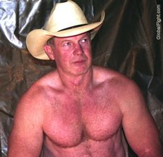 older muscular cowboy daddy wearing hat