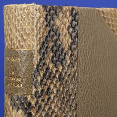 by Sangorski & Sutcliffe, 'Snakes' specially bound in real snake skin early 1900s ?