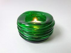 Votive holder:  kiln-formed glass...base and stacked rings cut from Perrier bottle, upcycled, recycle