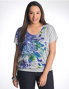 Floral graphic tee takes a feminine statement and makes it shine with rhinestone embellishments. In a flattering banded bottom silhouette with a scoop neck and short sleeves. lanebryant.com